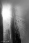 skyscraper in Seattle, Washington, in fog and mist with sunburst