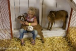 better with her face, but not with goat in arms